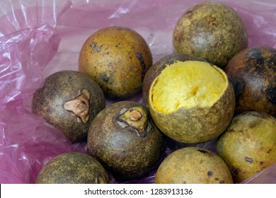 Brazilian fruit: stack of macauba on pink plastic bag. Fruit palm is consumed in natura and produces excellent edible and industrial oils, including biodiesel