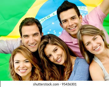 Brazilian group of people with the flag of Brazil