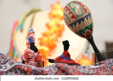 Brazilian handicrafts with percussion instrument and African dolls