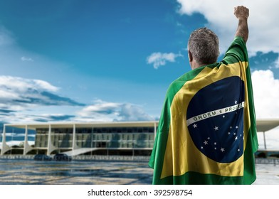 Brazilian holding the flag of Brazil in Brasilia