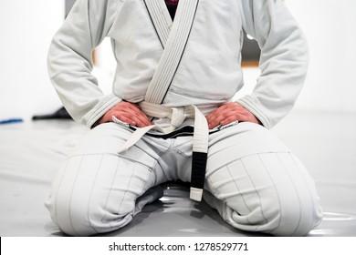 Brazilian Jiu JItsu BJJ WHite Belt Fighter Sitting in training