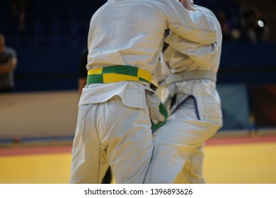 Brazilian jiujitsu fighters in a fight stand up wrestling at the tournament BJJ