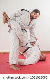 Brazilian jiu-jitsu training demonstration in traditional kimono. BJJ Standing guard pass