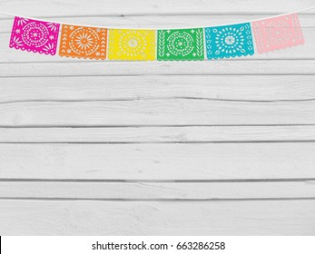 Brazilian june party, Festa junina mockup. Birthday decorative scene. String of handmade cut paper flags. Party decoration. White wooden background, empty space. Top view.