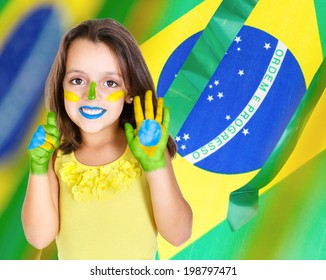 Brazilian kid fan or supporter celebrates the championship or competition or cup.