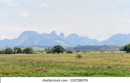 Brazilian landscape, road trip in the Espirito Santo state. Wide valleys, nice greenery of atlantic forest and mountains in the background
