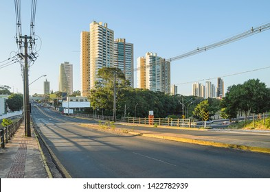Brazilian large avenue with few cars, electric poles, and few buildings on background. Pedro Chaves dos Santos viaduct of the Ceara Avenue at the capital city, Campo Grande - MS, Brazil.