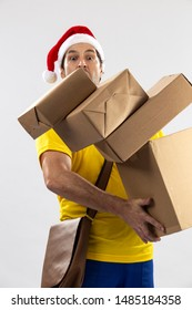 Brazilian mailman dressed as Santa Claus dropping packages on a white background. copy space.