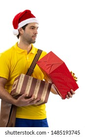 Brazilian mailman dressed as Santa Claus delivering a gift on a white background. copy space.