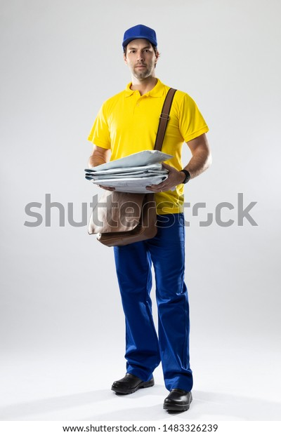Brazilian mailman on a white background delivering a package. copy space.