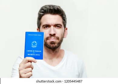 Brazilian man with document work and social security, (Carteira de Trabalho e Previdencia Social) on white background