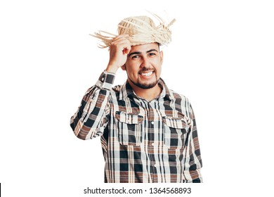 Brazilian man wearing traditional clothes for Festa Junina - June festival - isolated on white background