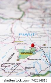 Brazilian Map close up. Serra da Capivara National Park, at Piaui State pinned on a map of Brazil. Selective focus.