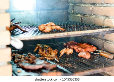 Brazilian meat grilling at a churrasco on a churrasqueira