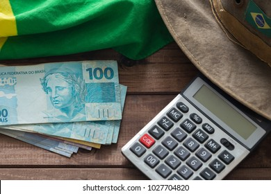 brazilian money and calculator on the wooden background