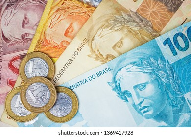 Brazilian money and coins on a table. Economy concept image.
