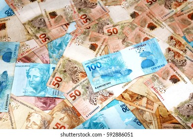 Brazilian money notes of 100 and 50 reais - Shutterstock ID 592886051