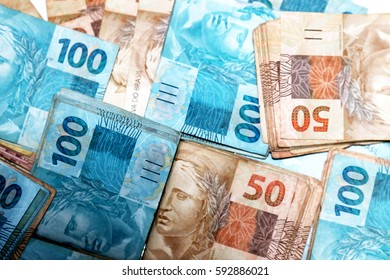 Brazilian money packages with notes in different values - Shutterstock ID 592886021