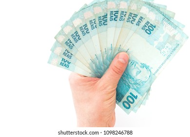 Brazilian money, reais, high denominations held in the palm of your hand
