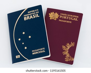 "Brazilian passport (Translation ""Brazil Republic federal mercosul passport"") and portuguese passport (Translation ""European Union Portugal passport"") white background."
