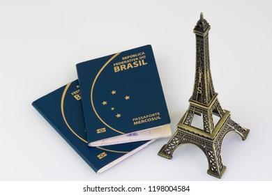 """Brazilian passport (Translation """"Brazil Republic federal mercosul passport"""")  and Eiffel Tower white background."""