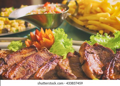 Brazilian Picanha Steak with farofa, fries and campanha sauce. Brazilian steak. Meat sliced.