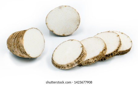 Brazilian potato known as yam, white background. In some places, it is common to refer to the following species Alocasia, Colocasia, Xanthosoma and Ipomoea, also as yam. Their tubers are also called y