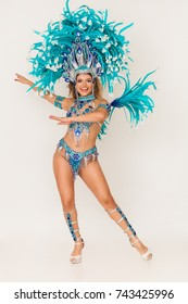 Brazilian samba dancer portrait wearing blue traditional costume and performing
