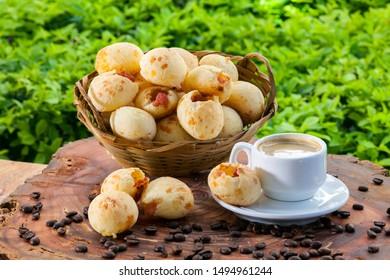 Brazilian snack cheese bread, pao de queijo, Brazilian snack cheese bread stuffed with pepperoni and a cup of coffee