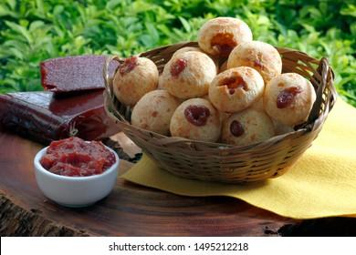 Brazilian snack cheese bread, pao de queijo stuffed with guava