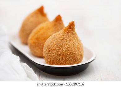 Brazilian snack coxinha de frango on dish
