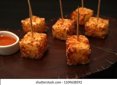 Brazilian snack dadinho de tapioca. Finger food appetizer made of tapioca and coalho cheese.