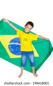 Brazilian soccer fan or supporter celebrates the championship or competition or cup.