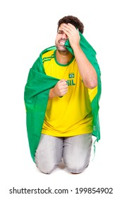 Brazilian soccer fan or supporter crying in the championship or competition or cup.