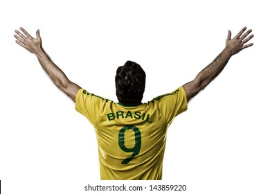 Brazilian soccer player, celebrating with the fans, on a white background.
