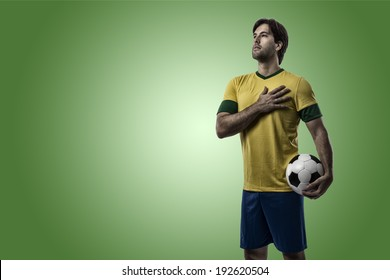 Brazilian soccer player, celebrating on a green background.
