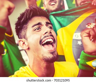 Brazilian Supporter Cheering at the Stadium