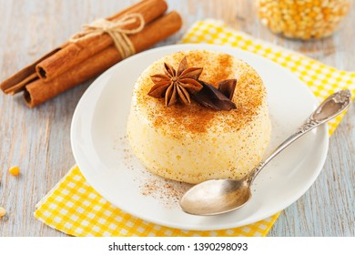 Brazilian sweet custard-like dessert curau de milho mousse of corn with cinnamonon a light background.