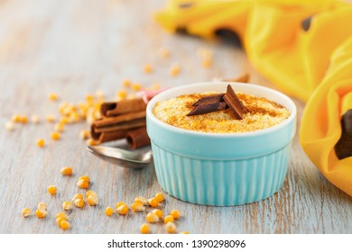 Brazilian sweet custard-like dessert curau de milho mousse of corn with cinnamonon a light background. Corn porridge with cinnamon in a bowl.