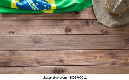 Brazilian symbols on a wooden background with space for inscription