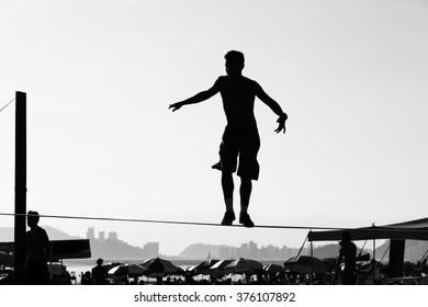 Brazilian teenager playing slackline