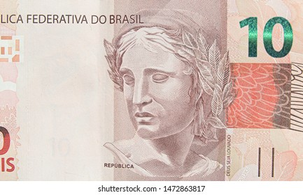 Brazilian ten real banknote. Red note, 10 reais brl. Brazilian money, real note. Macro photo.