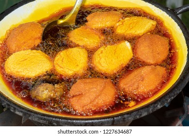 Brazilian tradictional patties, Acaraje, beans frying on palm oil.