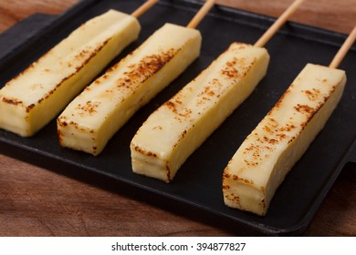 Brazilian traditional cheese queijo coalho on pan on wooden background; Selective focus