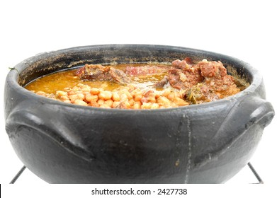 Brazilian typical food Feijoada in a mud pot.