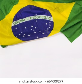 Brazilian waving flag isolated on white background. Concept Image.