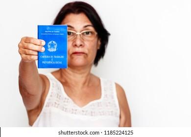 Brazilian woman with document work and social security, (Carteira de Trabalho e Previdencia Social) on white background