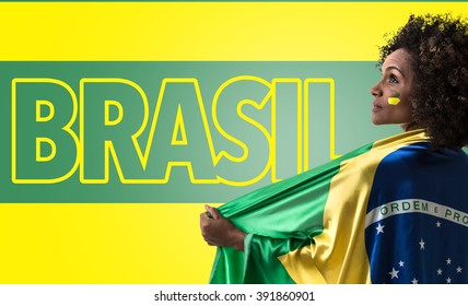 Brazilian woman holding the flag of Brasil and the Text: Brasil