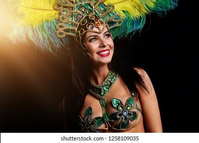 Brazilian woman posing in samba costume over black background