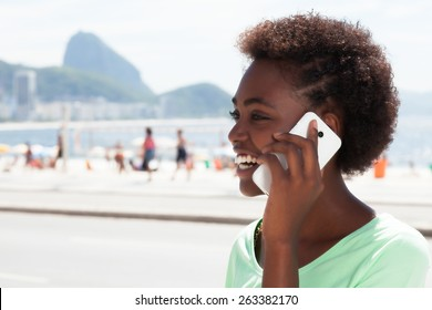 Brazilian woman at Rio de Janeiro speaking at phone